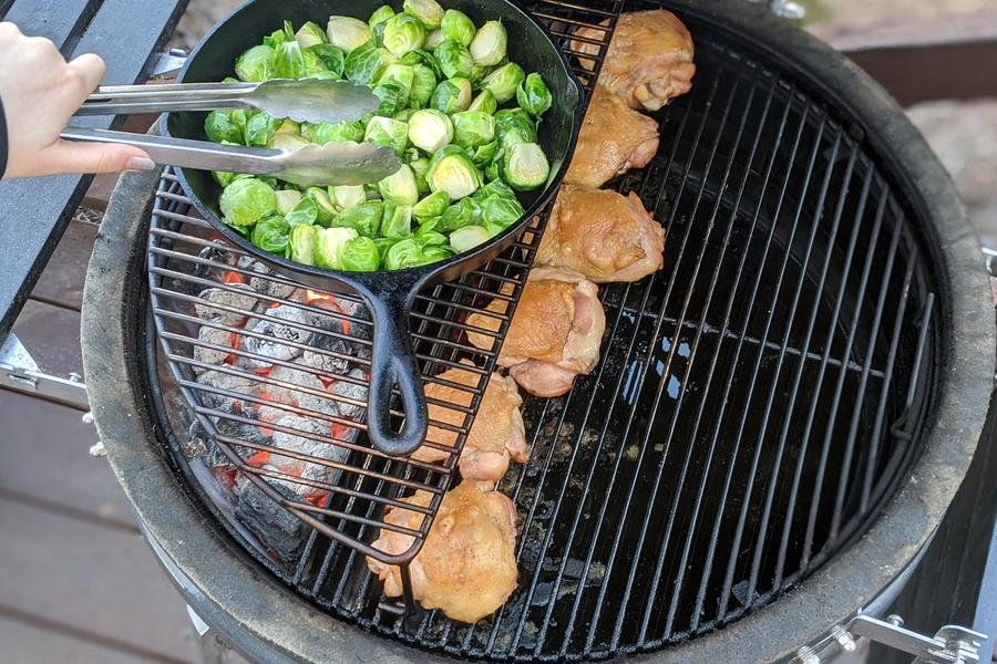 This image shows the SnS Kamado BBQ Australia in use cooking vegetables and chicken