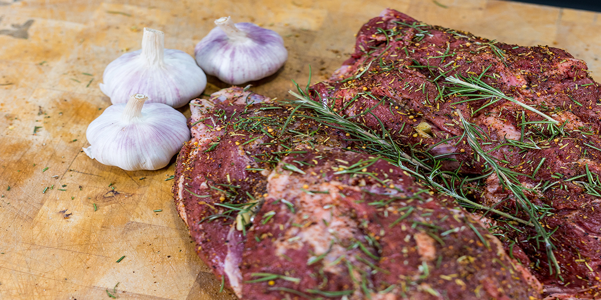 This image shows a lamb with rosemary and garlic