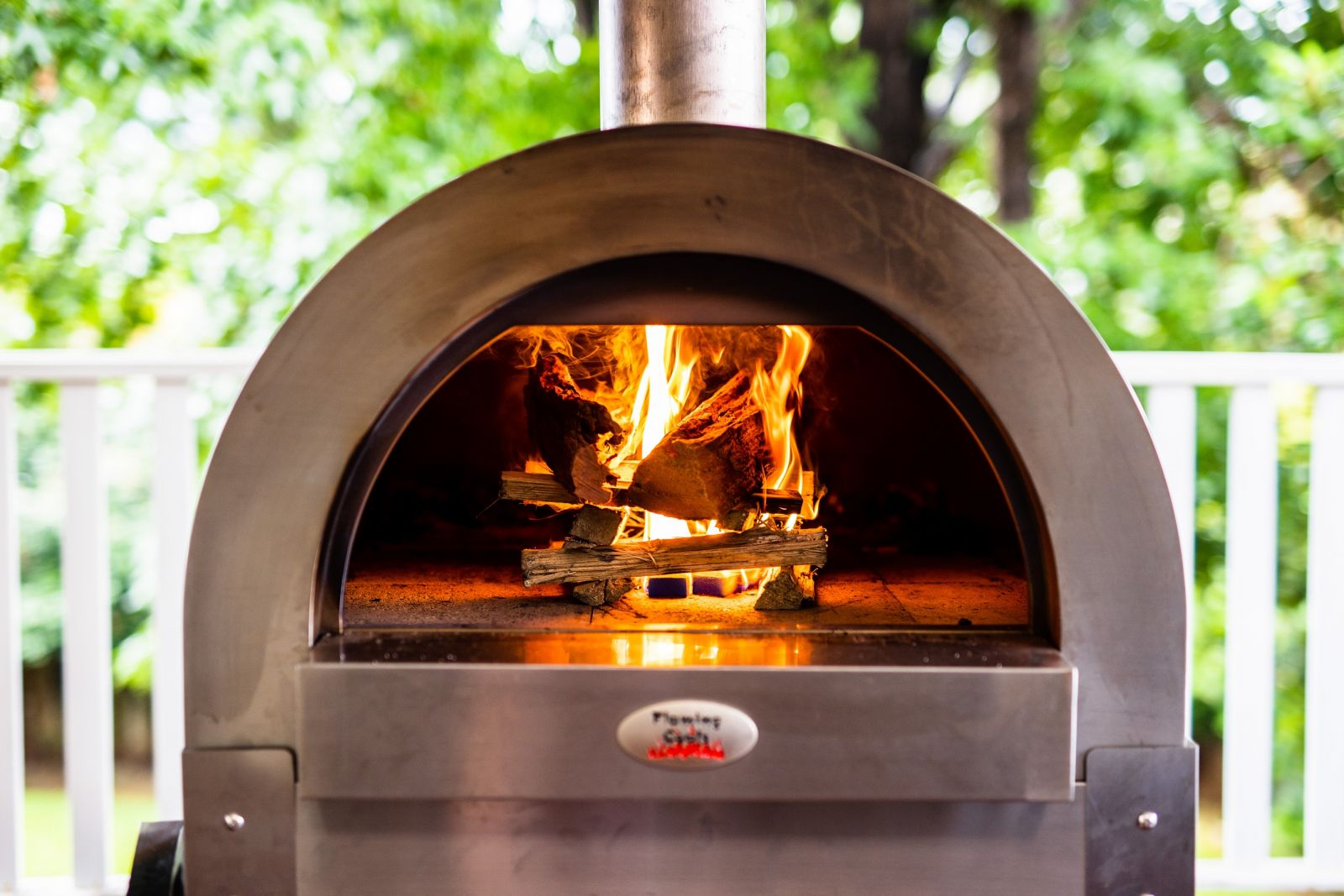 The image shows a running Large Stainless Steel Wood Fired Pizza Oven