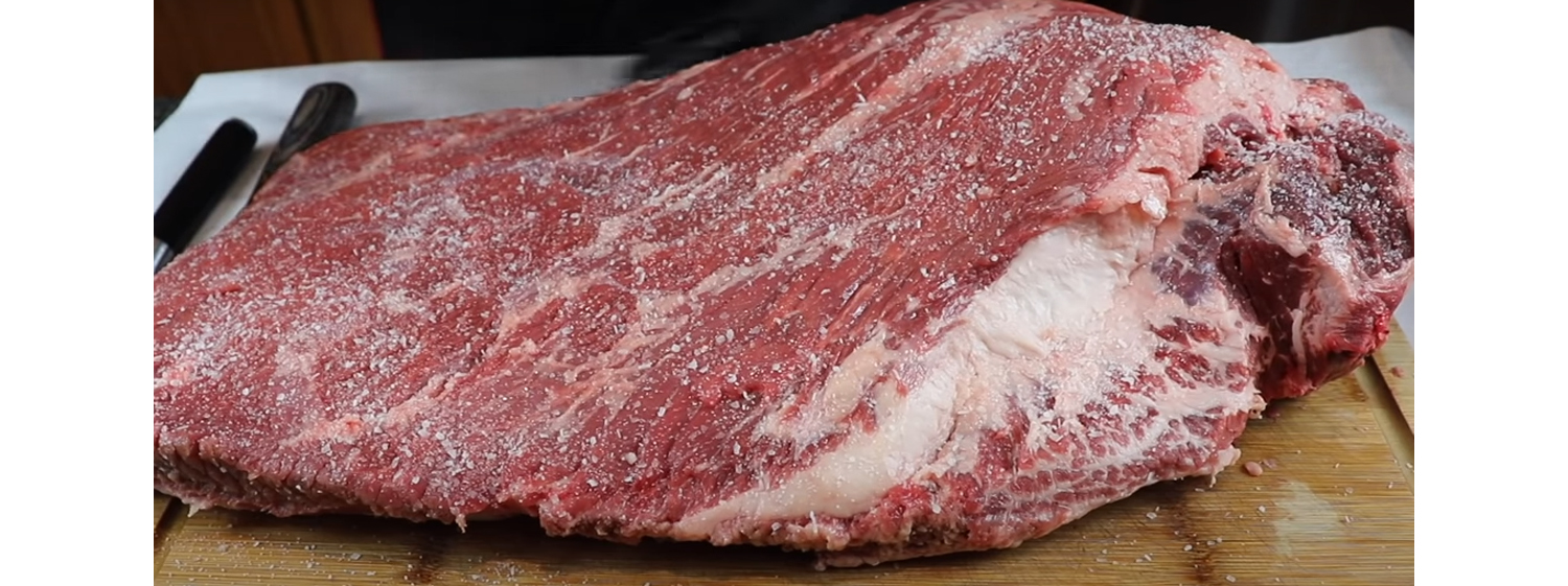 This image shows a brisket seasoned with salt.